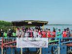 DLH Makassar, Gojek dan Mitra Hijau Asia Menanam Mangrove di Lantebung